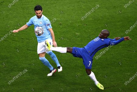 Manchester City's Ilkay Gundogan fights for the ball against Chelsea's N'Golo Kante during the Champions League final soccer match between Manchester City and Chelsea at the Dragao Stadium in Porto, Portugal