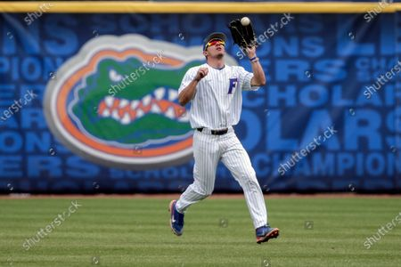 Florida outfielder Jacob Young catches a fly ball for an out on Tennessee's Max Ferguson in the first inning of an NCAA college baseball game during the Southeastern Conference tournament, in Hoover, Ala
