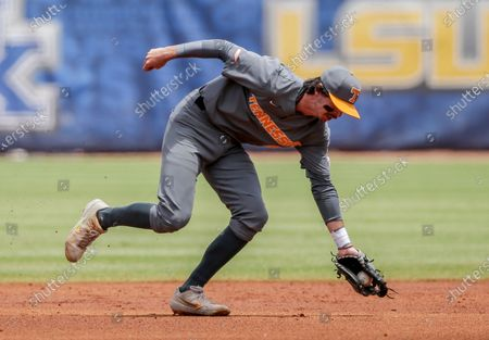 Stock Image of Tennessee infielder Liam Spence fields a ground ball hit by Florida's Jacob Young in the first inning of an NCAA college baseball game during the Southeastern Conference tournament, in Hoover, Ala