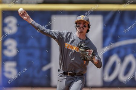 Tennessee infielder Liam Spence throws to first for the out on Florida's Jacob Young in the eighth inning of an NCAA college baseball game during the Southeastern Conference tournament, in Hoover, Ala