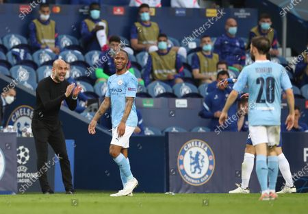 Manchester City's head coach Pep Guardiola, left, gives instructions to his players during the Champions League final soccer match between Manchester City and Chelsea at the Dragao Stadium in Porto, Portugal