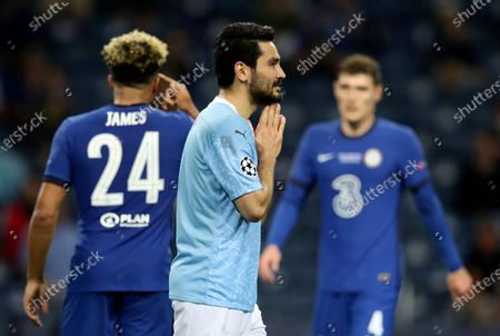 Manchester City's Ilkay Gundogan, center, reacts during the Champions League final soccer match between Manchester City and Chelsea at the Dragao Stadium in Porto, Portugal