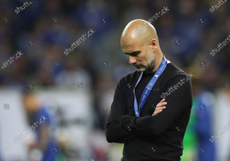Manchester City's head coach Pep Guardiola reacts during awarding ceremony after the Champions League final soccer match between Manchester City and Chelsea at the Dragao Stadium in Porto, Portugal