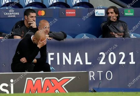 Manchester City's head coach Pep Guardiola, front left, reacts during the Champions League final soccer match between Manchester City and Chelsea at the Dragao Stadium in Porto, Portugal