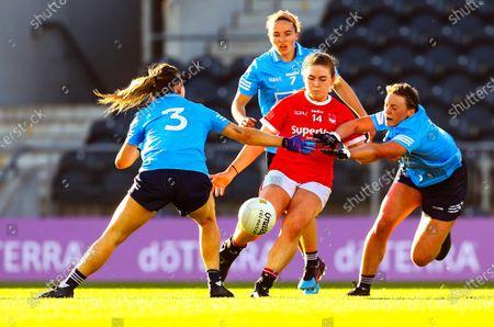 Cork vs Dublin. Cork's Libby Coppinger is tackled by Martha Byrne and Laura McGinley of Dublin