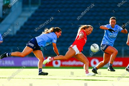 Cork vs Dublin. Cork's Sadhbh O'Leary shoots under pressure from Martha Byrne and Laura McGinley of Dublin