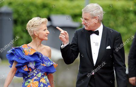 Swedish politician and diplomat Carl Bildt (R) and wife Anna Maria Corazza Bildt