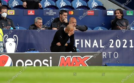 Manchester City manager Pep Guardiola (C) reacts during the UEFA Champions League final between Manchester City and Chelsea FC in Porto, Portugal, 29 May 2021.