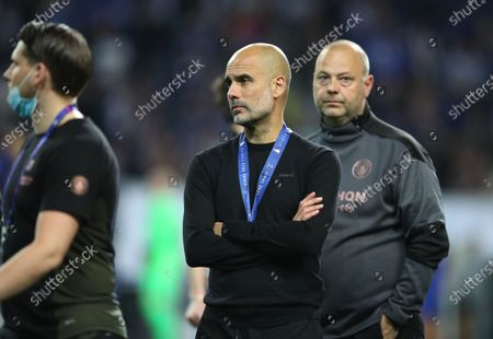 Manchester City manager Pep Guardiola (C) reacts after the UEFA Champions League final between Manchester City and Chelsea FC in Porto, Portugal, 29 May 2021.