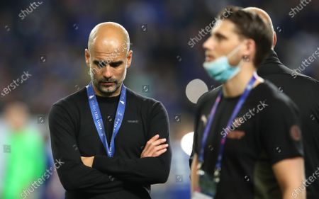 Manchester City manager Pep Guardiola (L) reacts after the UEFA Champions League final between Manchester City and Chelsea FC in Porto, Portugal, 29 May 2021.