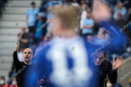 Manchester City manager Pep Guardiola gestures on the touchline during the UEFA Champions League final between Manchester City and Chelsea FC in Porto, Portugal, 29 May 2021.