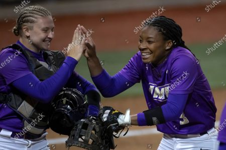James Madison catcher Lauren Bernett (22) and pitcher Odicci Alexander (3) celebrate their 2-1 win over Missouri during a NCAA softball game on in Columbia, Mo