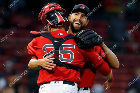 Boston Red Sox's Matt Barnes and Kevin Plawecki (25) celebrate after defeating the Miami Marlins in the ninth inning of a baseball game, in Boston