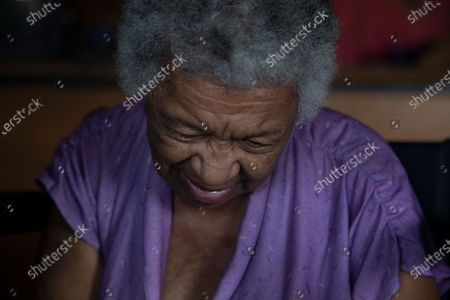 Dulce Carreno, 81, smiles during a home visit by Dr. Javier Manrique in the Las Minas neighborhood of Caracas, Venezuela, . Manrique visits the elderly in their home as a way to help them from having to go out amid the new coronavirus pandemic