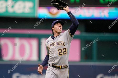 Milwaukee Brewers left fielder Christian Yelich makes a catch on a ball hit by Washington Nationals' Starlin Castro during the seventh inning in the first baseball game of a doubleheader, in Washington. The Brewers won 4-1