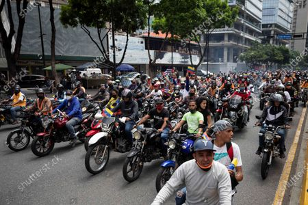 Supporters of the government of Nicolas Maduro participate in a motorized caravan, in Caracas, Venezuela, 29 May 2021. More than a hundred motorcyclists from the so-called Chavista 'motorized force' together with the mobilization front of the ruling United Socialist Party of Venezuela (PSUV) carried out a caravan in Caracas to show solidarity with Cuba and reject the US 'blockade' against both countries.