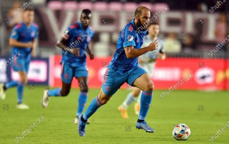 Stock Photo of Inter Miami forward Gonzalo Higuain (9) brings the ball up the field against D.C. United during the first half of an MLS soccer match, in Fort Lauderdale, Fla