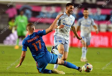 United defender Brendan Hines-Ike (4) avoids the tackle of Inter Miami defender Ryan Shawcross (17) during the second half of an MLS soccer match, in Fort Lauderdale, Fla