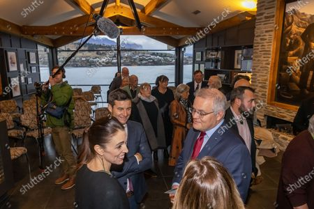 Australian Prime Minister Scott Morrison (R) and wife Jenny Morrison chat to New Zealand Prime Minister Jacinda Ardern (L) and her partner Clarke Gayford after the Powhiri (traditional Maori greeting) at the annual Australia-New Zealand Leaders' Meeting at the annual Australia-New Zealand Leaders' Meeting at the Rees Hotel in Queenstown, New Zealand, 30 May 2021.