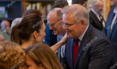 Australian Prime Minister Scott Morrison (R) and New Zealand Prime Minister Jacinda Ardern talk during the Powhiri (traditional Maori greeting) at the annual Australia-New Zealand Leaders' Meeting at the Rees Hotel in Queenstown, New Zealand, 30 May 2021.