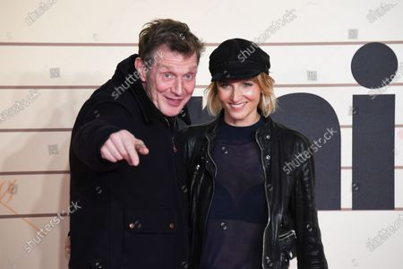 Stock Photo of Jason Flemyng and Elly Fairman attend the Military Wives UK Premiere at Cineworld Leicester Square on February 24, 2020 in London, England.