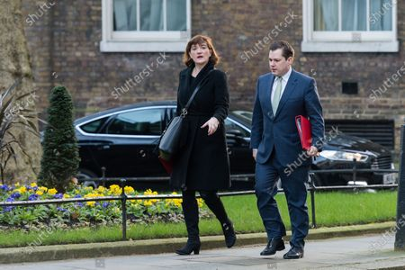Secretary of State for Digital, Culture, Media and Sport Baroness Nicky Morgan (L) and Secretary of State for Housing, Communities and Local Government Robert Jenrick (R) arrive in Downing Street in central London to attend a Cabinet meeting on 06 February, 2020 in London, England.