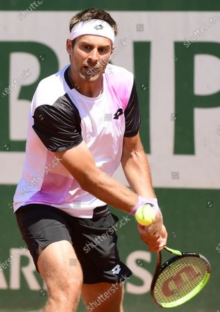 Norbert Gombos of Slovakia in action against Pablo Carreno Busta of Spain during their first round match at the French Open tennis tournament at Roland Garros in Paris, France, 30 May 2021.