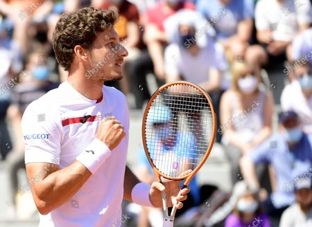 Pablo Carreno Busta of Spain in action against Norbert Gombos of Slovakia during their first round match at the French Open tennis tournament at Roland Garros in Paris, France, 30 May 2021.