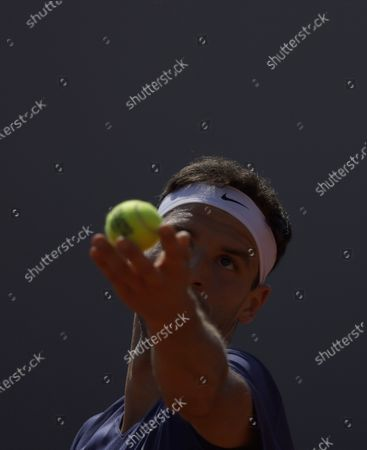 Grigor Dimitrov of Bulgaria in action against Marcos Giron of the USA during their first round match at the French Open tennis tournament at Roland Garros in Paris, France, 30 May 2021.