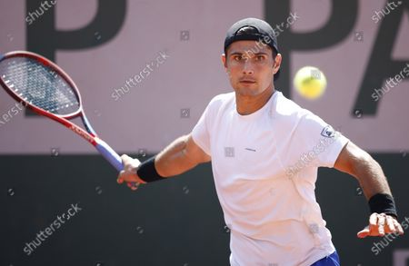 Marcos Giron of the USA in action against Grigor Dimitrov of Bulgaria during their first round match at the French Open tennis tournament at Roland Garros in Paris, France, 30 May 2021.