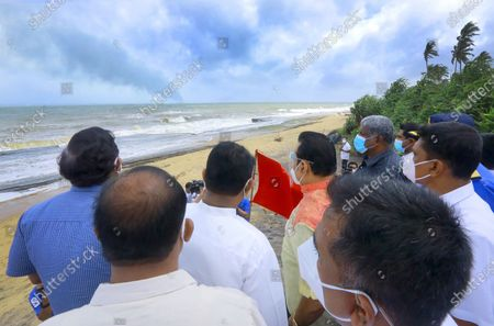 (210529) - COLOMBO, May 29, 2021 (Xinhua) - Sri Lankan Prime Minister Mahinda Rajapaksa (C) inspects the coastal area affected by the debris from the X-Press Pearl ship, in Colombo, Sri Lanka, on May 29, 2021. Sri Lankan Prime Minister Mahinda Rajapaksa on Saturday made an inspection visit to the coastal area in Uswetakeiyawa on the outskirts of capital Colombo which is affected by the debris washed up from the fire-ravaged container ship X-Press Pearl, the Prime Minister's Office said.