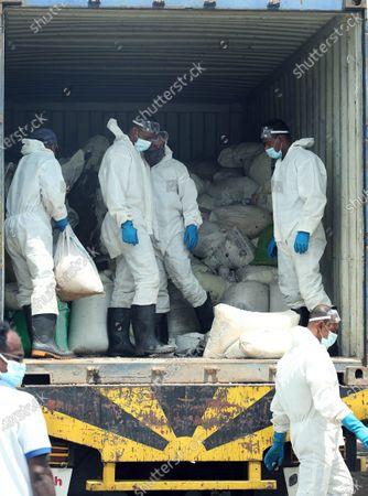 Stock Picture of (210529) - COLOMBO, May 29, 2021 (Xinhua) - Sri Lankan security personnel load up a truck with debris from the X-Press Pearl ship in Colombo, Sri Lanka, on May 29, 2021. Sri Lankan Prime Minister Mahinda Rajapaksa on Saturday made an inspection visit to the coastal area in Uswetakeiyawa on the outskirts of capital Colombo which is affected by the debris washed up from the fire-ravaged container ship X-Press Pearl, the Prime Minister's Office said. During the inspection visit, the prime minister issued directives to the officials to expedite the provision of relief to the fishermen affected by the situation, a statement from the Prime Minister's Office said.