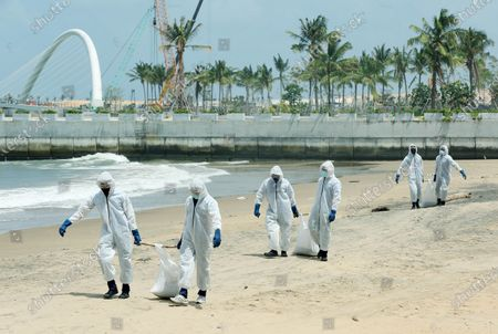 (210529) - COLOMBO, May 29, 2021 (Xinhua) - Sri Lankan security personnel remove debris from the X-Press Pearl ship on a beach in Colombo, Sri Lanka, on May 29, 2021. Sri Lankan Prime Minister Mahinda Rajapaksa on Saturday made an inspection visit to the coastal area in Uswetakeiyawa on the outskirts of capital Colombo which is affected by the debris washed up from the fire-ravaged container ship X-Press Pearl, the Prime Minister's Office said. During the inspection visit, the prime minister issued directives to the officials to expedite the provision of relief to the fishermen affected by the situation, a statement from the Prime Minister's Office said.