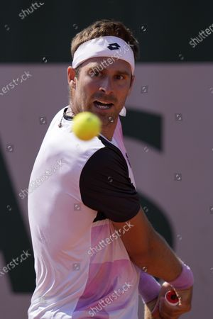 Slovakia's Norbert Gombos returns the ball to Spain's Pablo Carreno Busta during their first round match of the French Open tennis tournament at the Roland Garros stadium in Paris
