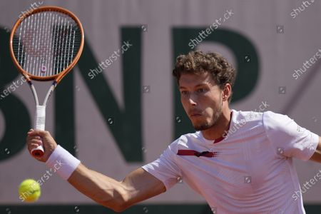 Spain's Pablo Carreno Busta returns the ball to Slovakia's Norbert Gombos during their first round match of the French Open tennis tournament at the Roland Garros stadium in Paris