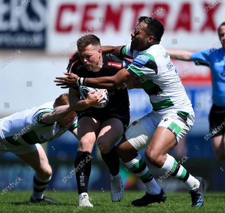 Joe Simmonds of Exeter Chiefs is tackled by George Wacokecoke of Newcastle Falcons