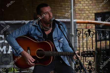 British singer and songwriter Miles Kane performs live at the Camden Market, London on July 25, 2020. Miles Kane performed at Camden's amphitheatre where the crowd attended following the measures of social distancing and wearing masks, as the Lockdown measures due To the coronavirus outbreak were eased.