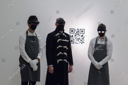 Staff members look at mixed reality installation 'The Life' (2018-2019) by Marina Abramovic (est. £400,000-800,000) through the VR headsets during a photo call for 20th Century: London to Paris sale series at Christie's on October 09, 2020 in London, England. The new sale series, jointly presented by Christie's London and Christie's Paris, celebrating the best in Impressionist, modern, post-war and contemporary art and design will take place on 22 and 23 October.