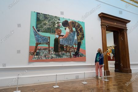 A gallery staff member looks at 'Blend in - Stand out' by Njideka Akunyili Crosby on display during a press preview of the 252nd Summer Exhibition at Royal Academy of Arts, on September 28, 2020 in London, England. The exhibition, which for the first time ever, due to COVID-19, takes place in the Autumn between 6 October 2020 and 3 January 2021, features over 1000 works in a range of media, by emerging and established artists.