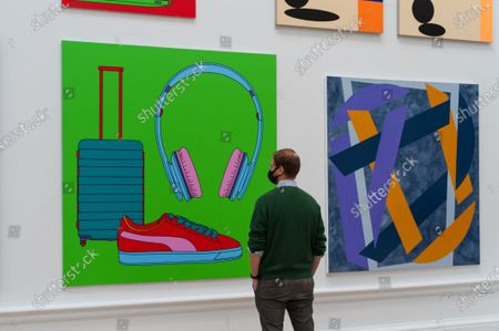 A gallery staff member looks at 'Untitled (with suitcase)' by Sir Michael Craig-Martin RA during a press preview of the 252nd Summer Exhibition at Royal Academy of Arts, on September 28, 2020 in London, England. The exhibition, which for the first time ever, due to COVID-19, takes place in the Autumn between 6 October 2020 and 3 January 2021, features over 1000 works in a range of media, by emerging and established artists.