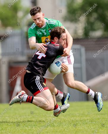 Stock Image of Down's Corey Quinn is tackled by James Dolan of Westmeath