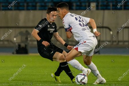 Stock Picture of Lee Si-Young of Seongnam FC competes for the ball with Kim Byeom-yong of Suwon FC during the K League 1 match between Seongnam FC and Suwon FC at the Tancheon Stadium in Seongnam, South Korea, 29 May 2021.