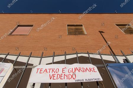 """Sign at the entrance of San Raffaele Theater in Rome against the closure of the Theater Italian actor Elio Germano, winner of David di Donatello 2021 award as best leading actor, joined the protest of managers of San Raffaele Theater in Trullo district in Rome, which is about to be closed by Vicariate after 40 years of management of """"Il Cilindro"""" association."""