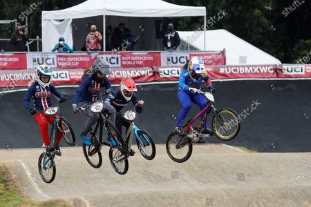 Mariana Pajon (R) of Colombia, Manon Valentino (C) of Francie and Ashley Verhagen (2-L) of USA compete during the women's elite final of the BMX World Cup on the track of El Salitre Park in Bogota, Colombia, 29 May 2021.