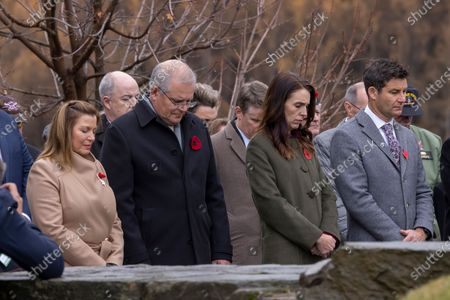 New Zealand  Prime Minister Jacinda Ardern (2-R) with partner Clarke Gayford (R), and Australian Prime Minister Scott Morrison (2-L) with his wife Jenny Morrison (L) take part in the wreath laying ceremony at the Arrowtown Cenotaph during the annual Australia-New Zealand Leaders' Meeting in Queenstown, New Zealand, 31 May 2021.