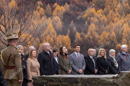 New Zealand Prime Minister Jacinda Ardern (6-R) with partner Clarke Gayford (5-R), and Australian Prime Minister Scott Morrison (7-R) with his wife Jenny Morrison (8-R) take part in the wreath laying ceremony at the Arrowtown Cenotaph during the annual Australia-New Zealand Leaders' Meeting in Queenstown, New Zealand, 31 May 2021.
