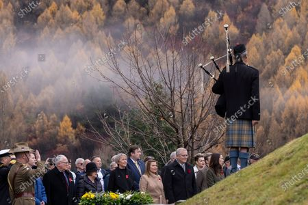 New Zealand Prime Minister Jacinda Ardern and Australian Prime Minister Scott Morrison, along with their respective partners, take part in the wreath laying ceremony at the Arrowtown Cenotaph during the annual Australia-New Zealand Leaders' Meeting in Queenstown, New Zealand, 31 May 2021.