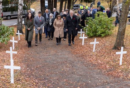 (Front row L-R) New Zealand Prime Minister Jacinda Ardern, her partner Clarke Gayford, Jenny Morrison and Australian Prime Minister Scott Morrison arrive at the wreath laying ceremony at the Arrowtown Cenotaph during the annual Australia-New Zealand Leaders' Meeting in Queenstown, New Zealand, 31 May 2021.