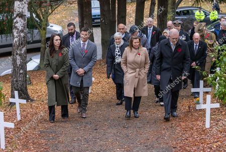 New Zealand  Prime Minister Jacinda Ardern (L) with partner Clarke Gayford (2-L), and Australian Prime Minister Scott Morrison (R) with his wife Jenny Morrison (2-R) arrive at the wreath laying ceremony at the Arrowtown Cenotaph during the annual Australia-New Zealand Leaders' Meeting in Queenstown, New Zealand, 31 May 2021.