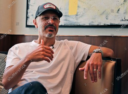 Stand-up comedian Maz Jobrani talks with the Associated Press in Dubai, United Arab Emirates, . For Iranian-American Maz Jobrani, a stand-up show in Dubai marked the first time he's been in front of a major live audience overseas since the start of the coronavirus pandemic and he feels it